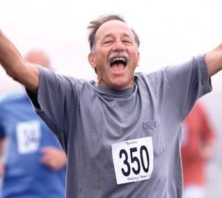 Senior running a race